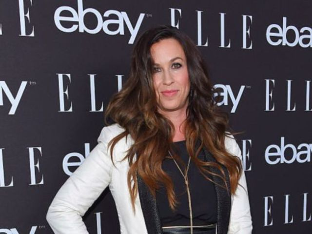 Alanis Morisette Posts Sweet Photo of Her Breastfeeding Newborn Son in Bed With Family