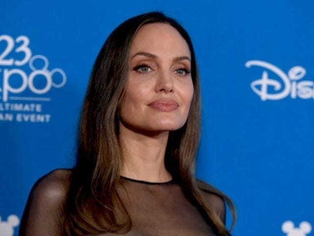 Angelina Jolie Meets Fan With Tattoo of Her Entire Face, Smoking in New Photo