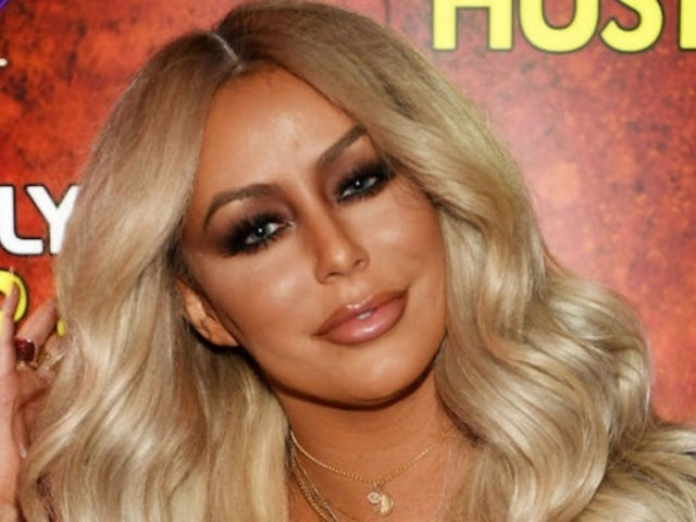 Aubrey O'Day Says Flight Attendant Made Her Take Her Shirt off Mid-Flight