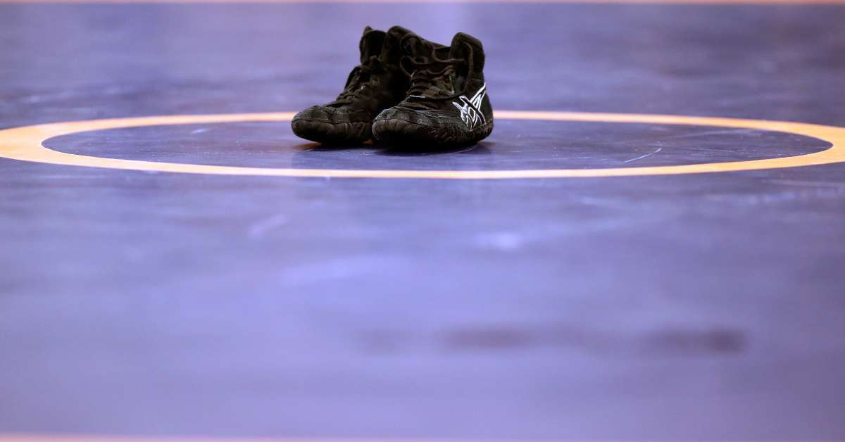 High School wrestling referee suspended two seasons cut dreadlocks