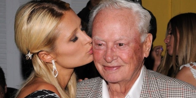 Paris Hilton Mourns Loss of Grandpa Barron, Hotel CEO and AFL Co-Founder, Dead at 91