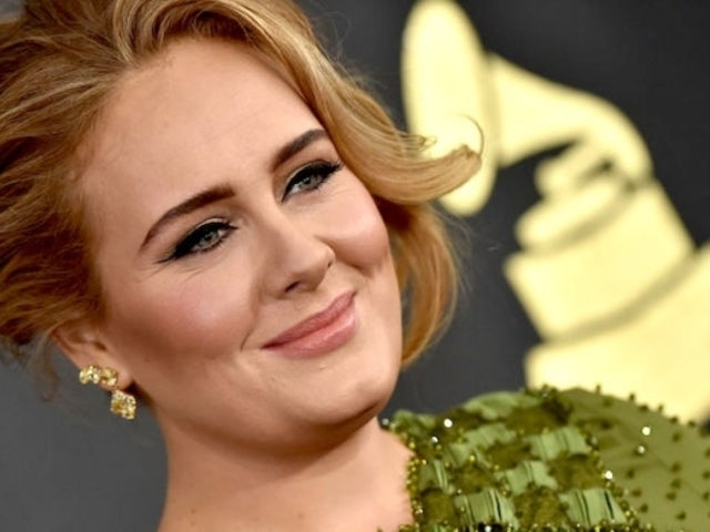 Adele Stuns in Bold Black Gown Amid Dramatic Transformation Following Divorce