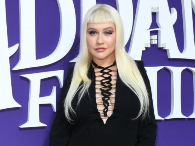 Christina Aguilera Goes Full 'Addams Family' in Morticia-like Gothic Outfit During Movie Premiere