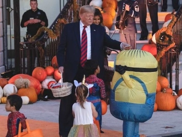 Donald Trump Halloween Moment Goes Viral When He Confuses Minion Trick-or-Treater