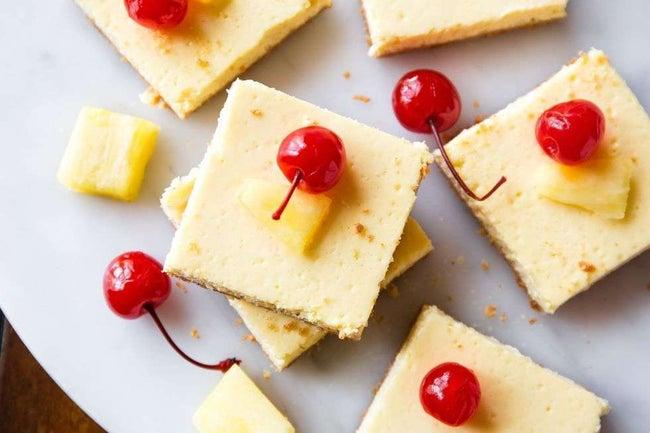 gallery-1452790603-delish-skinny-pineapple-cheesecake-bars-2