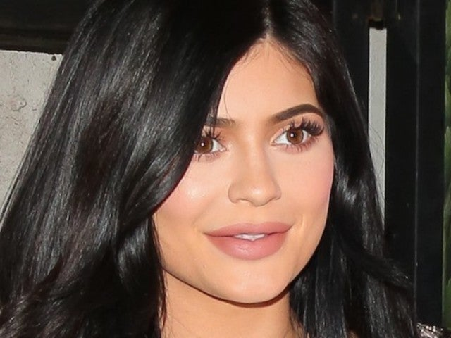 Kylie Jenner Posts Bizarre Public Shower Photo in Heels