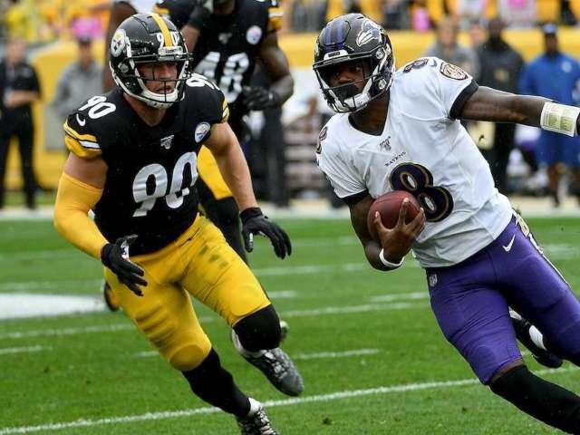 Ravens QB Lamar Jackson Checks in on Photographer He Knocked Over