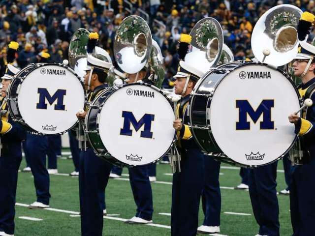 Michigan Marching Band Gets Acrobatic During Drumming Performance and Fans Have Questions