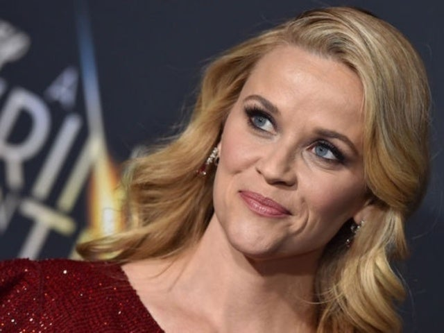 Reese Witherspoon Poses With Enormous Snake for Magazine Shoot
