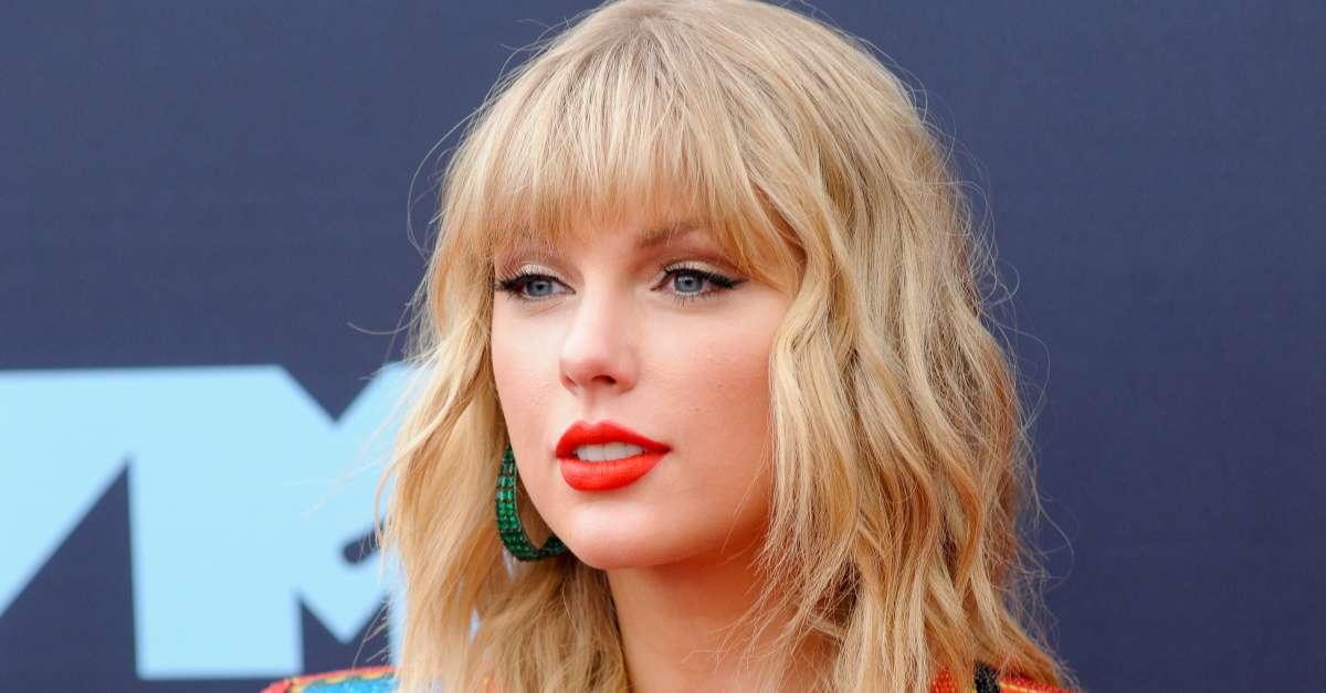 Taylor Swift banner LA Kings cover up fans jinx
