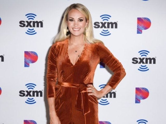Carrie Underwood Warms up for CMA Awards Performance While Rocking Cheetah-Print Workout Wear