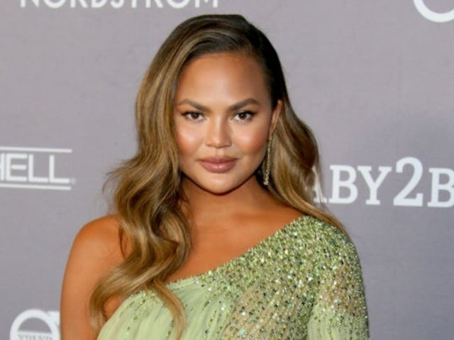 Chrissy Teigen Claps Back at Instagram Troll Criticizing a Firefighter Posing With Her Kids
