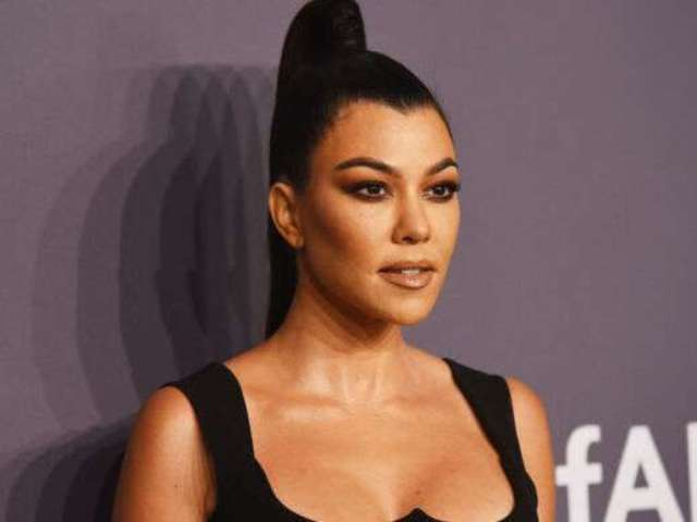 Kourtney Kardashian Reveals New Bikini Sunbathing Photo on Yacht Alongside Inspiring Words About Stretch Marks