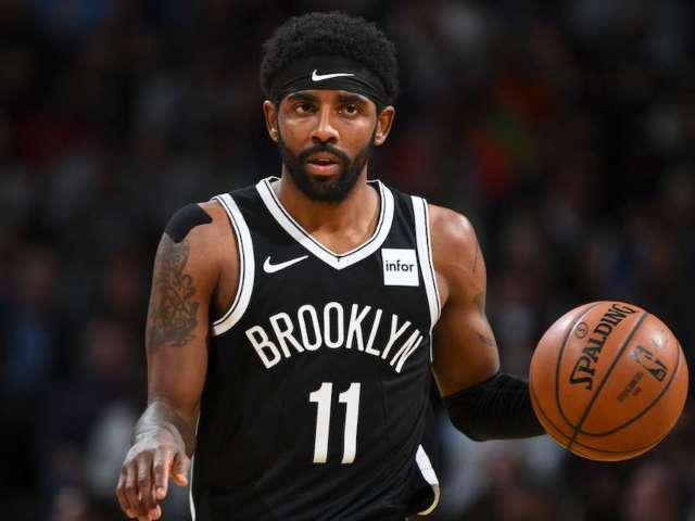 NBA Star Kyrie Irving Hands out $100 Bills to Kids Prior to Bulls-Nets Game