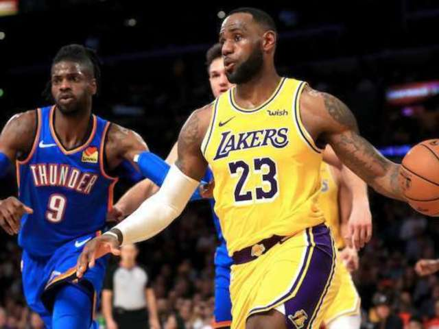 LeBron James Shows off Football Skills During Lakers Game