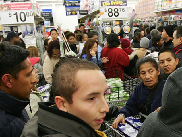 Black Friday: Walmart Shopper Takes Selfies as Fight Rages Behind Them
