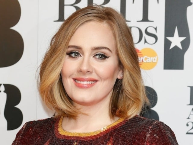 More Adele Beach Photos Surface Revealing Her Frolicking in the Water With a Drink