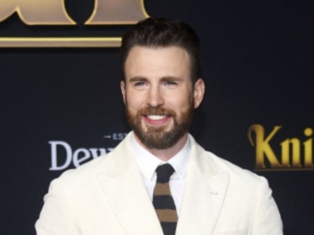 Chris Evans' 'Knives Out' Sweater Look Gets Upstaged by an Adorable Companion