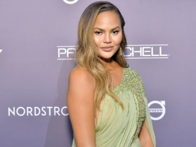 Chrissy Teigen Claps Back at Troll After Risque Photo With Daughter Luna