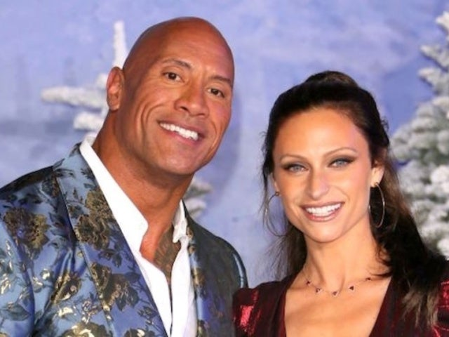 Dwayne 'The Rock' Johnson Plants Big Kiss on Lauren Hashian as Their Outfits Shimmer on 'Jumanji' Red Carpet