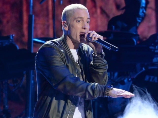 Eminem Gets Shaded by Grindr Over His 'Dolly Parton Challenge' Photo