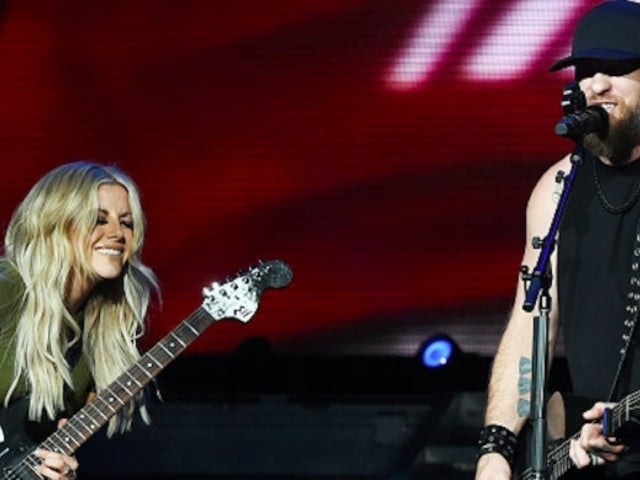 Brantley Gilbert and Lindsay Ell Celebrate 'What Happens in a Small Town' Hitting No. 1 (Exclusive)