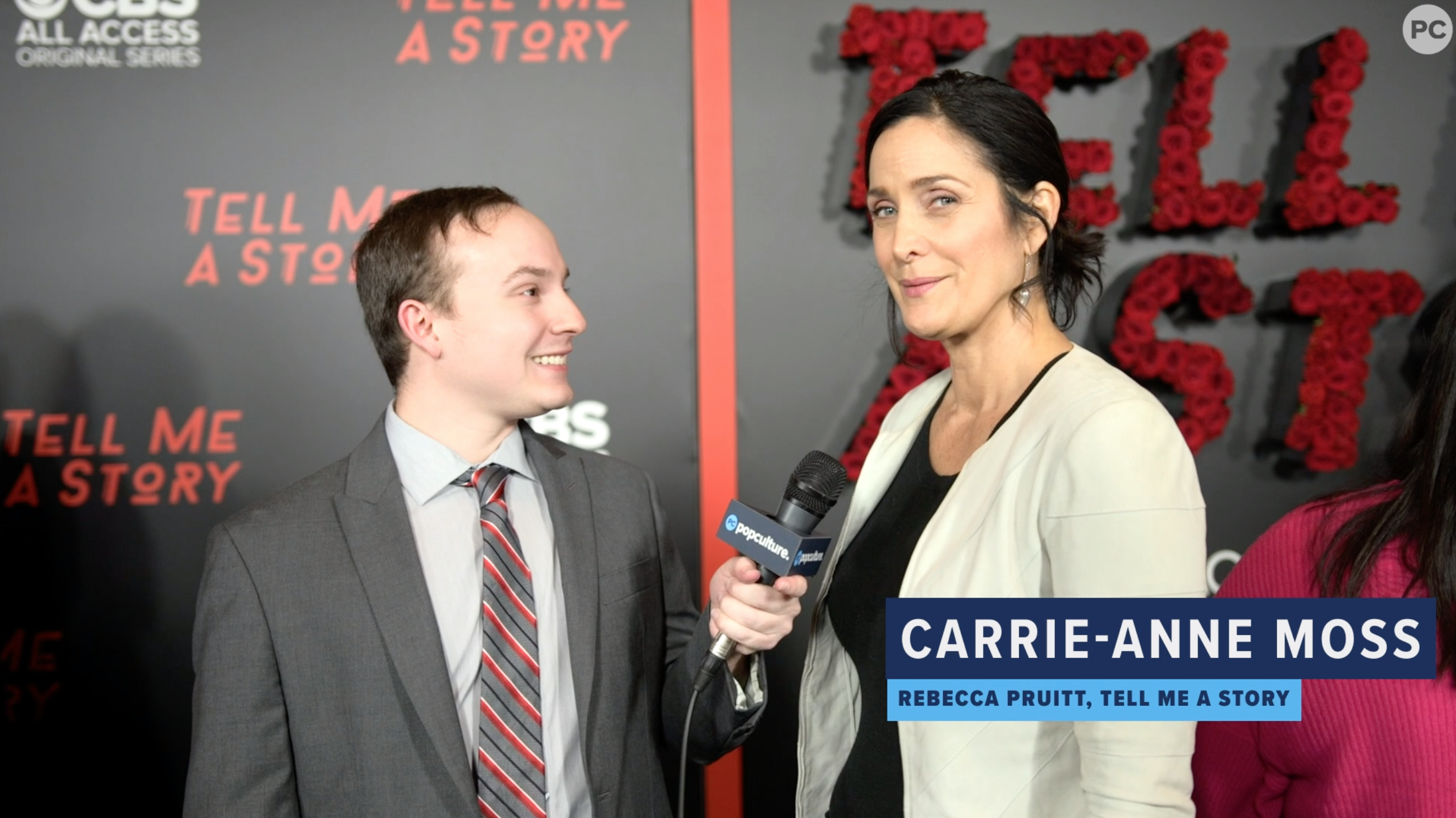 Carrie-Anne Moss Talks TELL ME A STORY screen capture