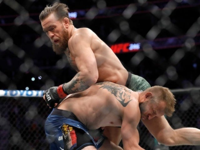 Conor McGregor Knocks out Donald 'Cowboy' Cerrone in Under a Minute, and Fans Are Losing It
