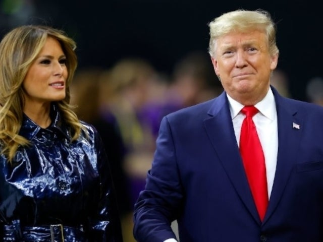 National Championship: Watch Melania Trump Rip Her Hand Away From Husband Donald During Anthem