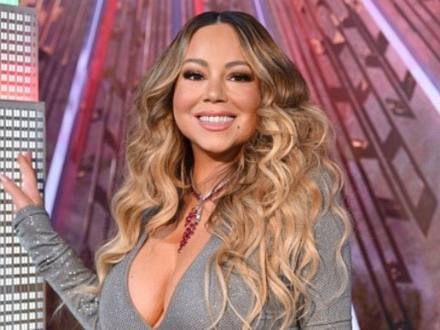 Mariah Carey Goes Swimming in Sequined Dress, and the Internet Has Thoughts