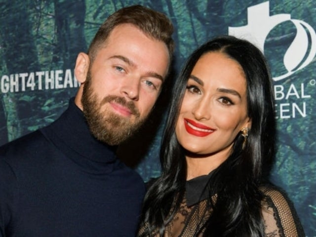 Nikki Bella Kisses Fiance Artem Chigvintsev While Showing off Growing Baby Bump