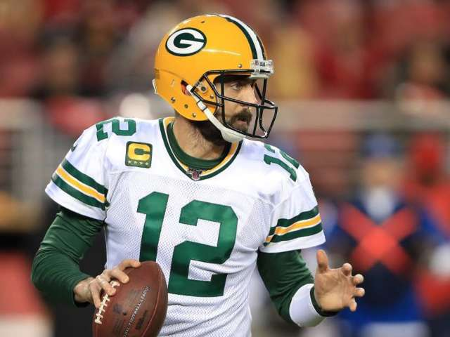 Packers QB Aaron Rodgers Surpasses Brett Favre for Playoff Touchdown Passes and Fans Have Mixed Reactions