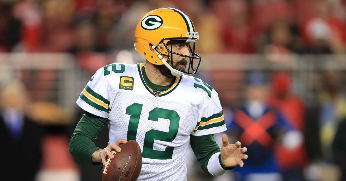 Packers Aaron Rodgers surpasses Brett Favre playoff touchdown passes fans mixed thoughts