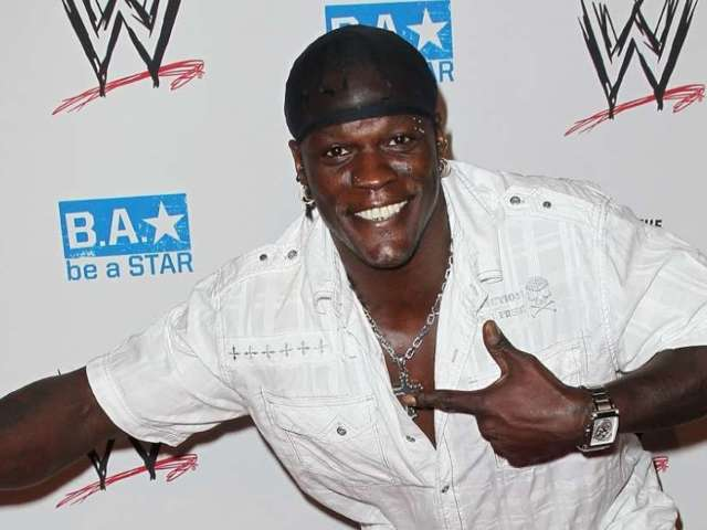 WWE's Ron Killings Lets Lauren Alaina Wear the 24/7 Championship in Fun New Photo