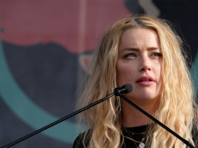 Amber Heard's Wine Selfie Is Getting Bombarded With Johnny Depp Fans After Assault Confession Leaks