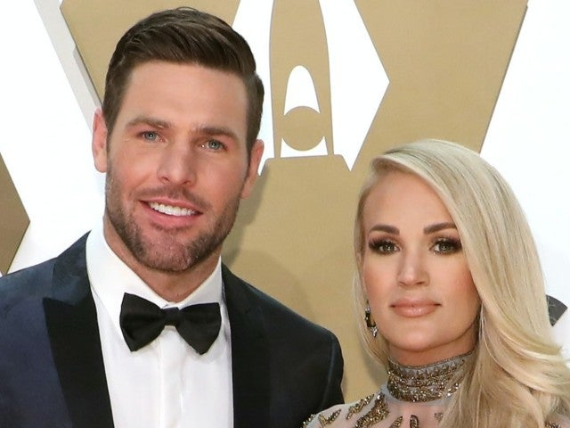 Carrie Underwood Attends Hockey Game With Husband Mike Fisher While Joking He Needs a Job