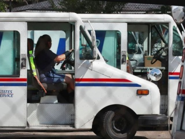 Ex-Postal Worker Charged in Dumping of Absentee Ballots