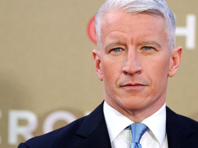 CNN's Anderson Cooper Struggles to Hold Back Tears During Interview With Woman Who Lost 32-Year-Old Husband to Coronavirus