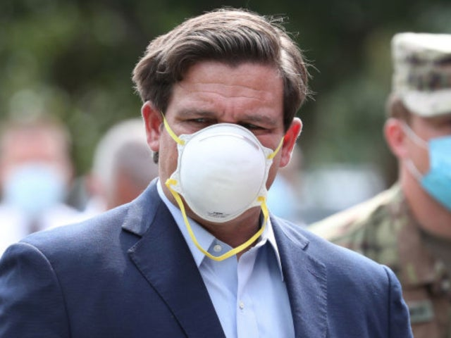Watch: Florida Governor Ron DeSantis Blunders Putting on Face Mask Amid Scrutiny
