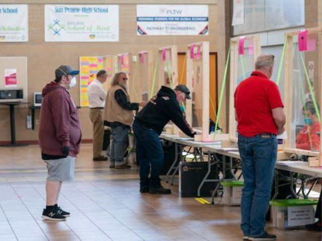 Photos Show Wisconsin Voters Trying to Socially Distance in Line at the Polls Amid Pandemic