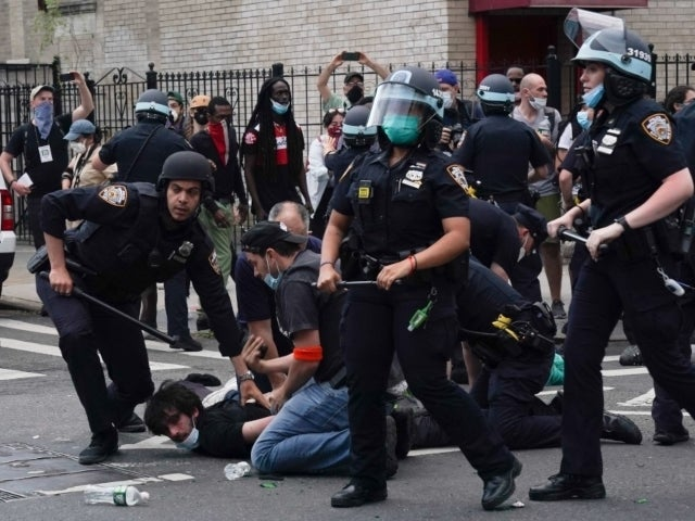 NYPD Officer Rams Police Car Into Protesters During Brooklyn Demonstration