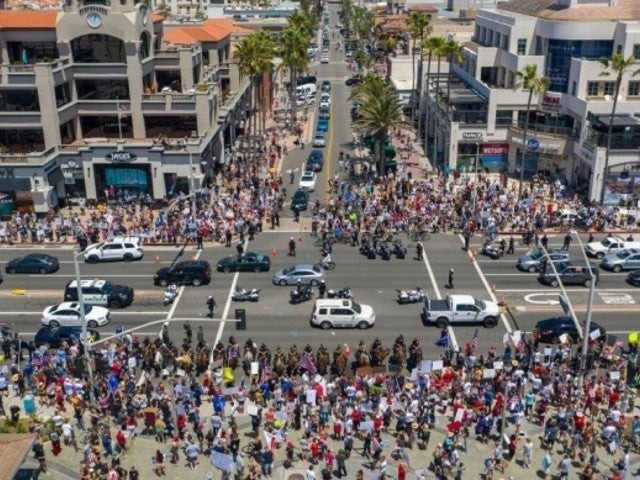 Thousands of Protesters Flood Huntington Beach to Protest Closures