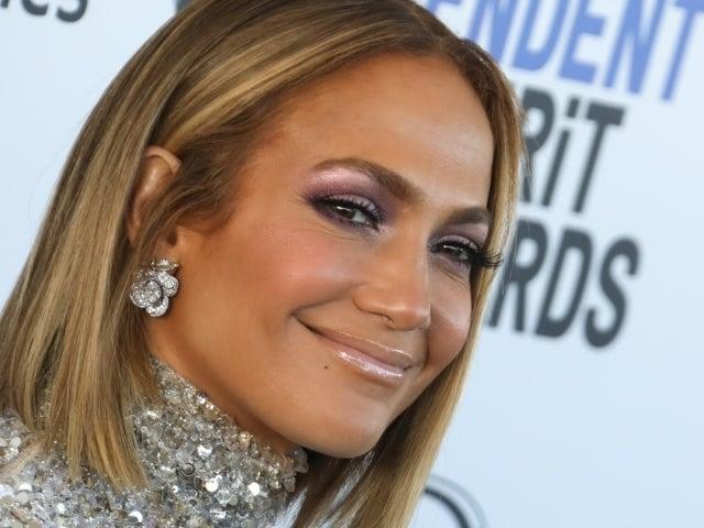 Jennifer Lopez Calms Fan Fears Over Mystery Man Hiding in Viral Workout Selfie