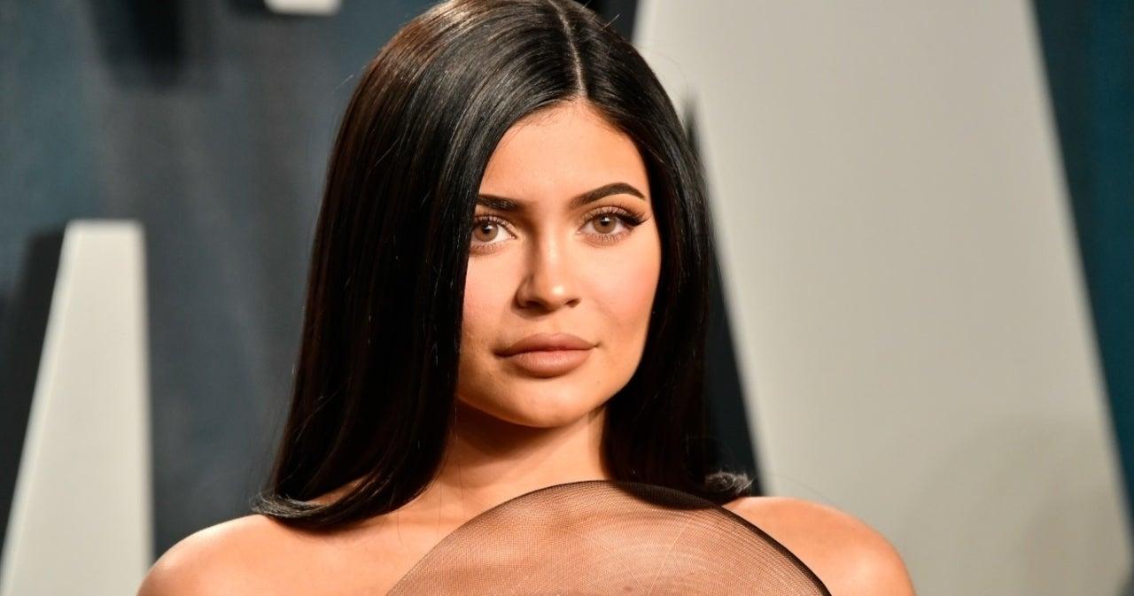 Kylie Jenner Stuns in Shades and Black Bikini Top.jpg