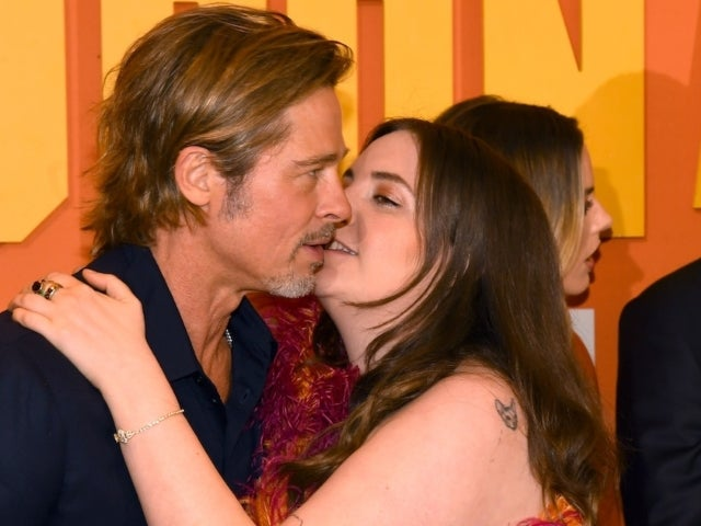 Lena Dunham Explains Awkward Kissing Photo With Brad Pitt