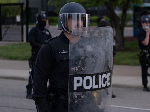 Watch: Flint, Michigan Sheriff Removes Riot Gear, Joins George Floyd Protest