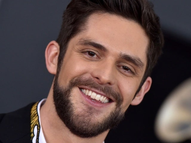 Thomas Rhett and Daughter Lennon Have Matching Hairdos in New Beach Photo