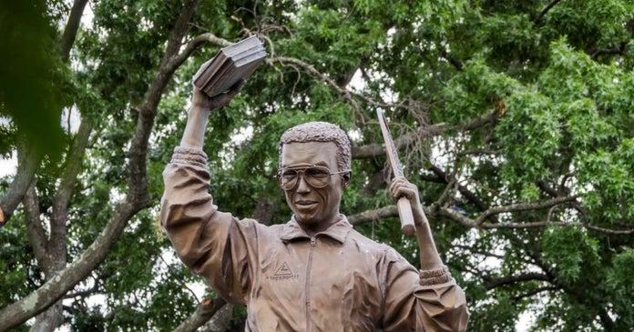 Arthur Ashe statue in Virginia vandalizes spray painted White Lives Matter graffiti