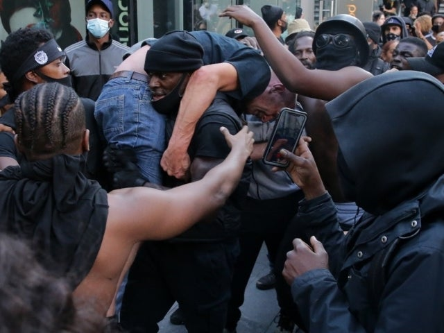White Man Saved by Black Lives Matter Protester in Viral Photo Is Former Police Officer