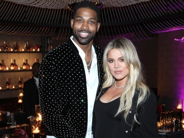 Tristan Thompson Cuddles up to Khloe Kardashian, Sneaks in a Kiss During Kim's 40th Birthday Party